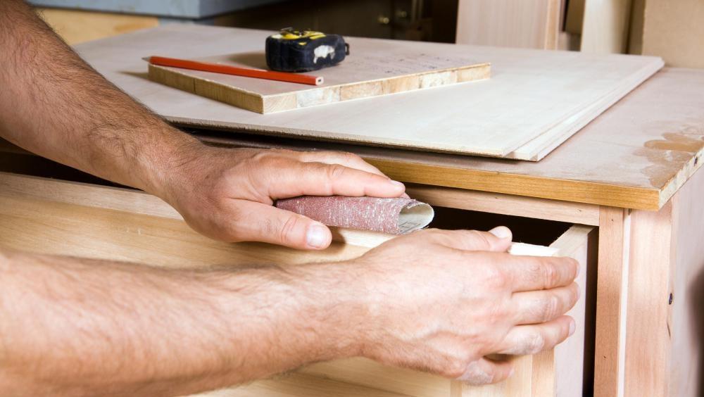 Inside Jodhpur Furniture Factory crafts men assembling the table
