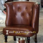 Wheel Base Leatherite Upholstered Tufted Chair
